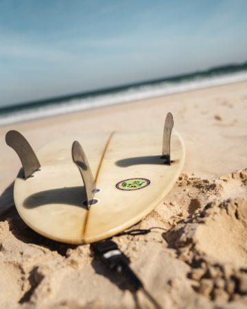 Surf lesson - surf board on beach